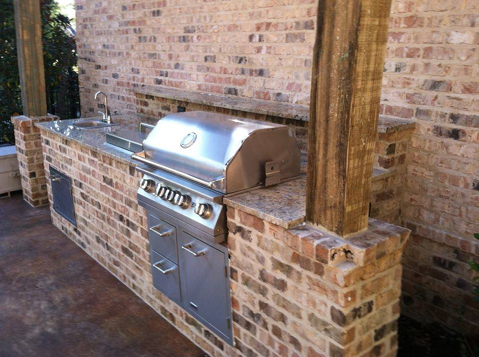 New Orleans outdoor kitchen with brick oven and BBQ